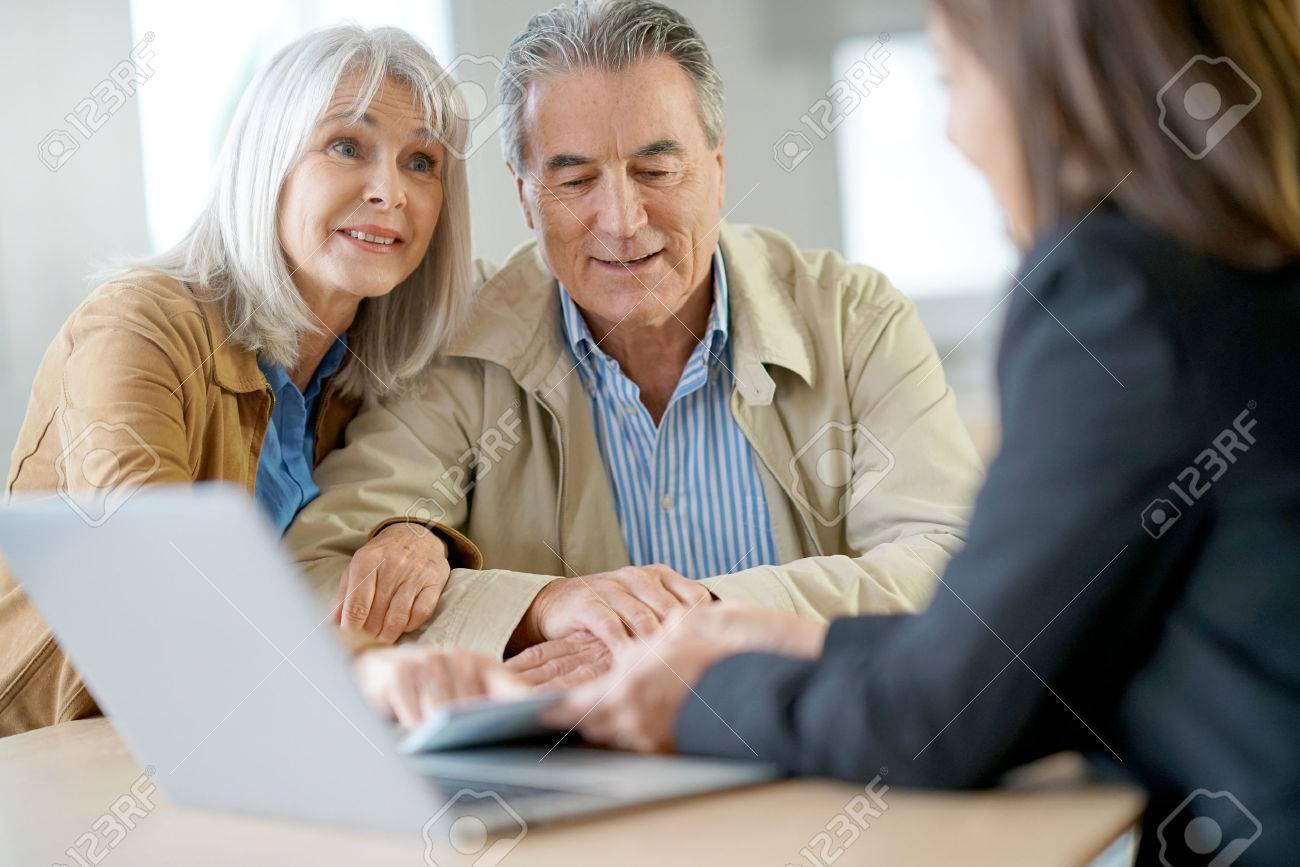 Senior couple meeting financial adviser for investment - 69227270