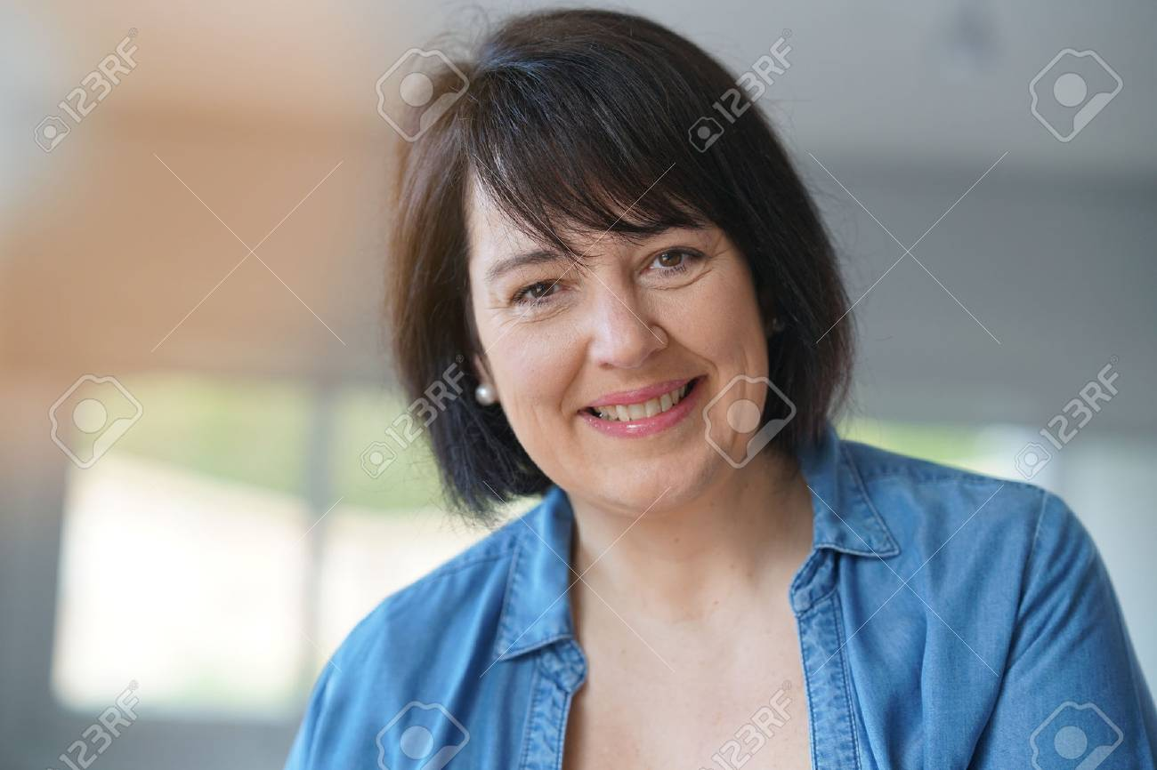 Portrait of smiling 50-year-old woman - 74768908