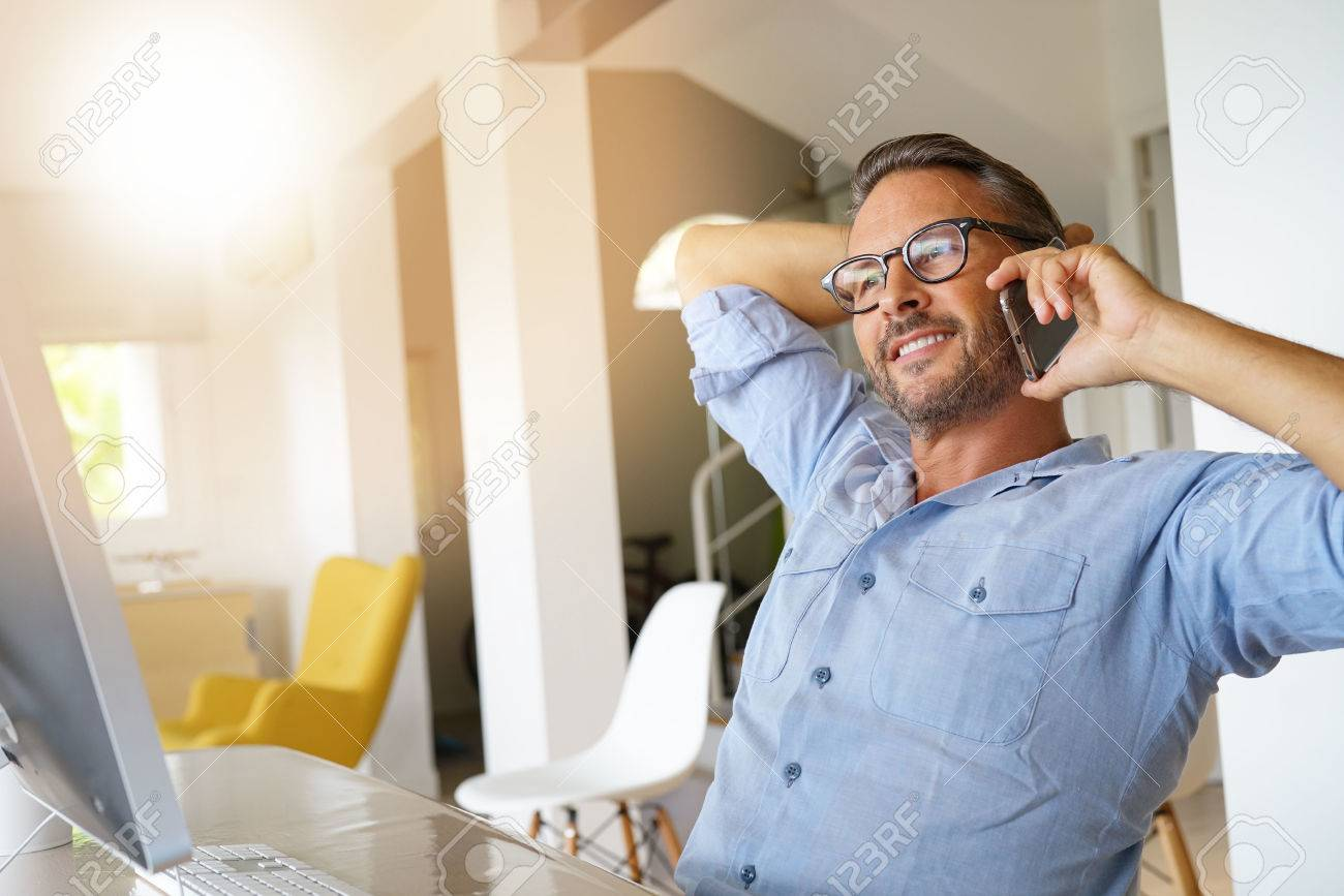 Home-office businessman talking on phone - 85319995