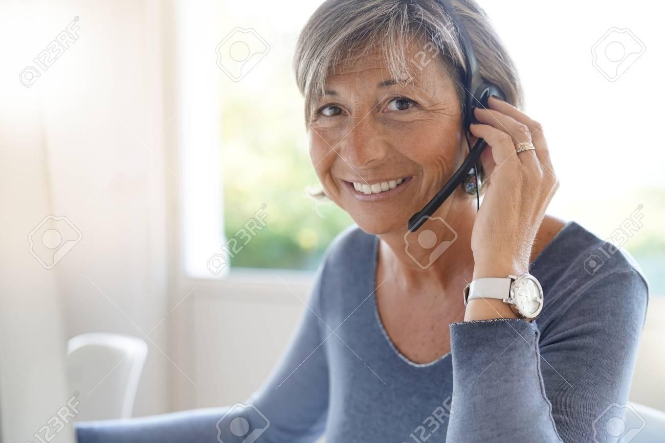 Senior sales representative working in office - 87528359