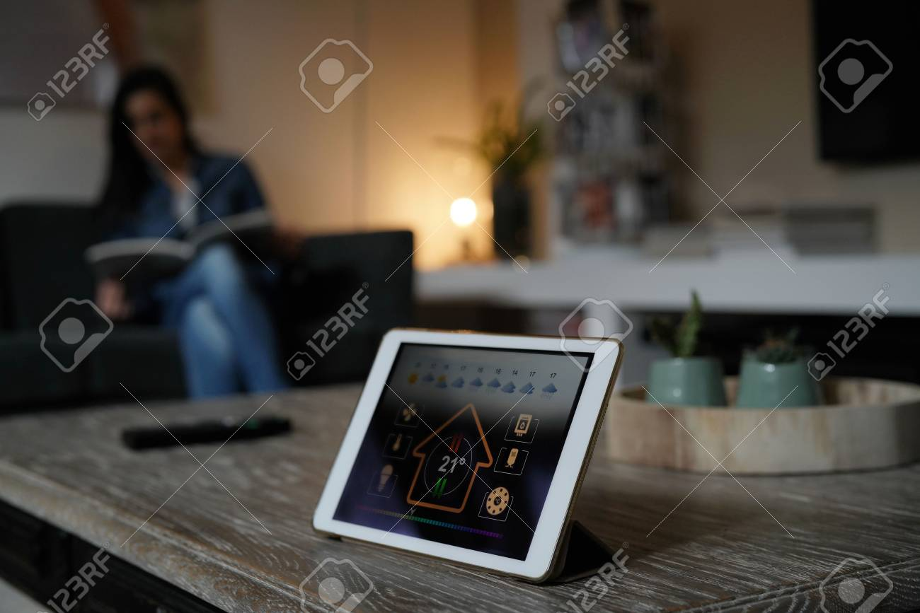 Closeup of digital tablet showing home control interface - 91613786