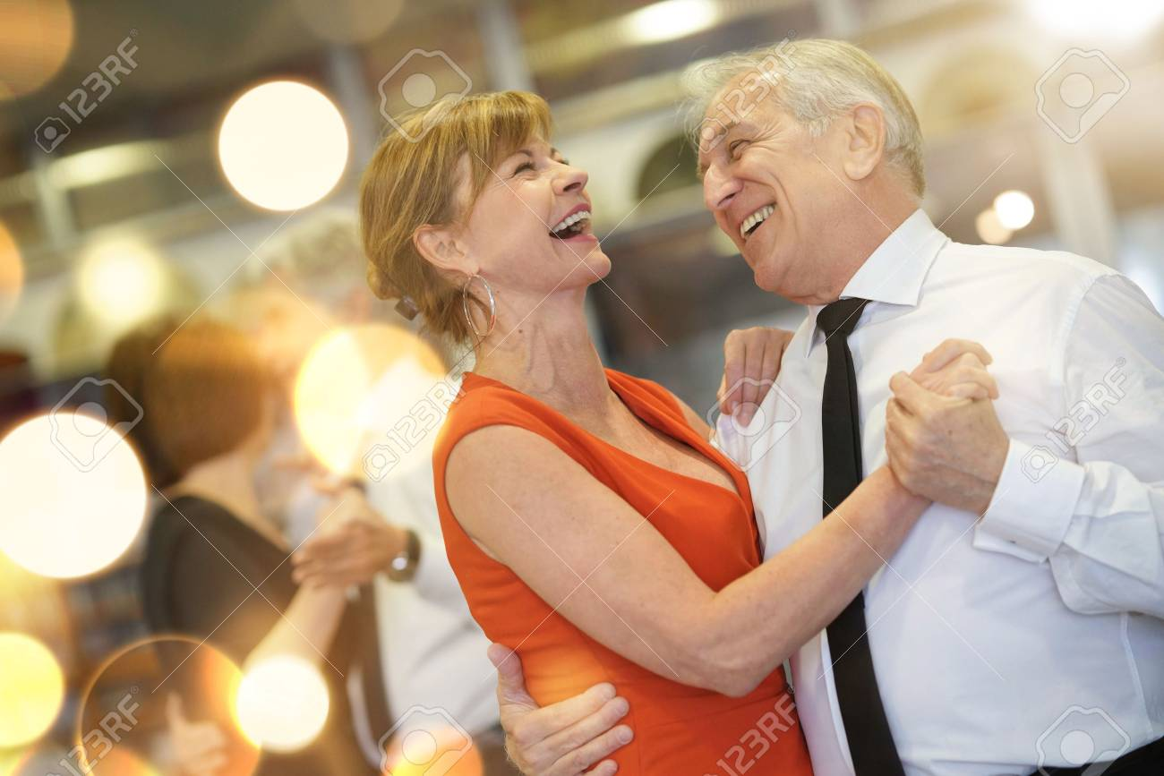 Romantic senior couple dancing together at dance hall - 98122285