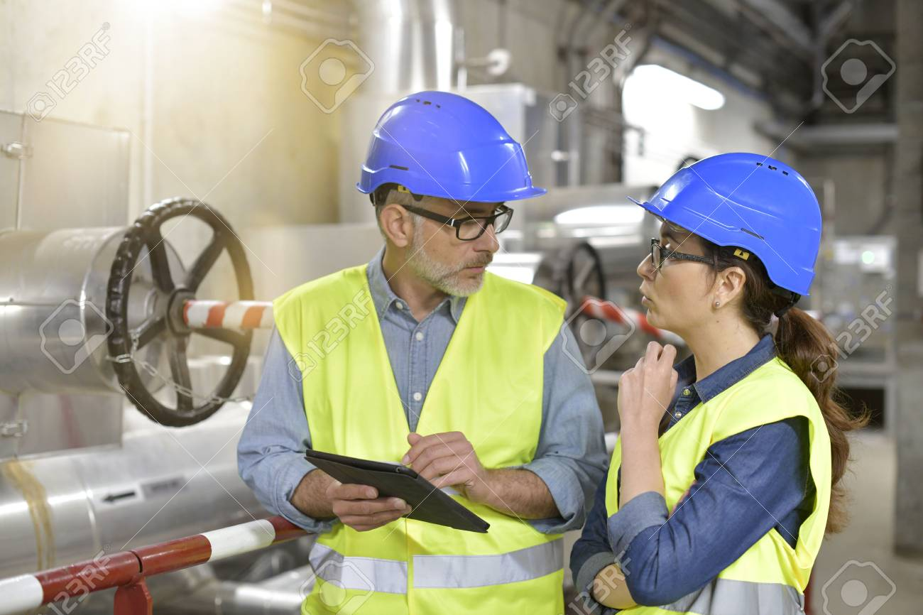 Industrial engineers working in recycling plant with tablet - 100712682