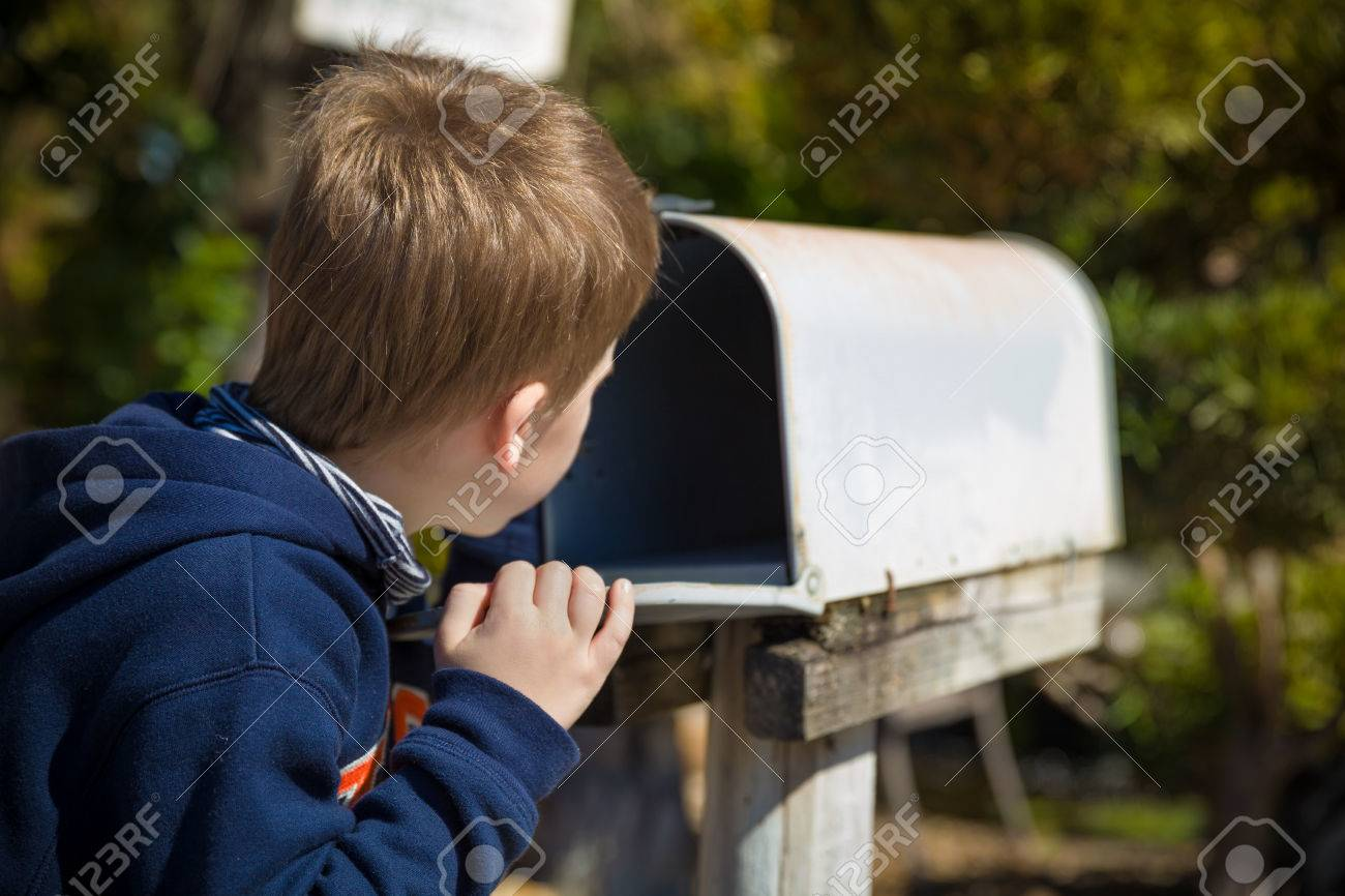 Waiting For Mail >> School Boy Opening A Post Box And Checking Mail Kid Waiting Stock