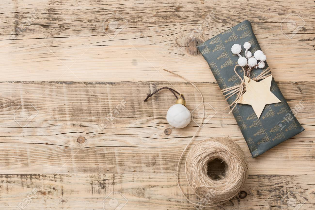 stock photo top view on nice christmas gifts packed in black and striped paper and decorated with stars on wooden background presents and decor elements - Nice Christmas Gifts