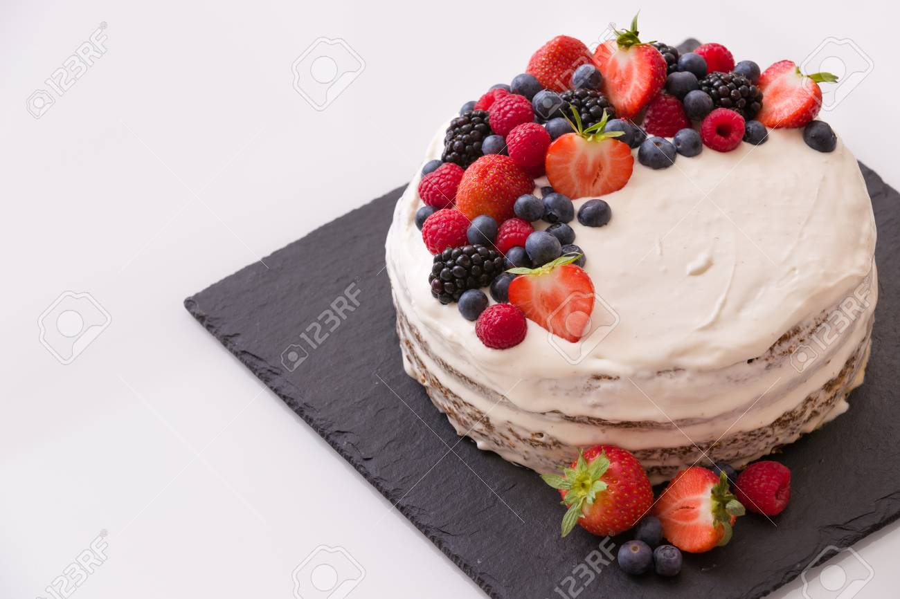 Top View On Homemade Vanilla Birthday Cake Decorated With Berries