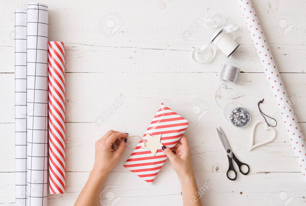 Top View On Girl S Hands Wrapping Christmas Or Birthday Gift