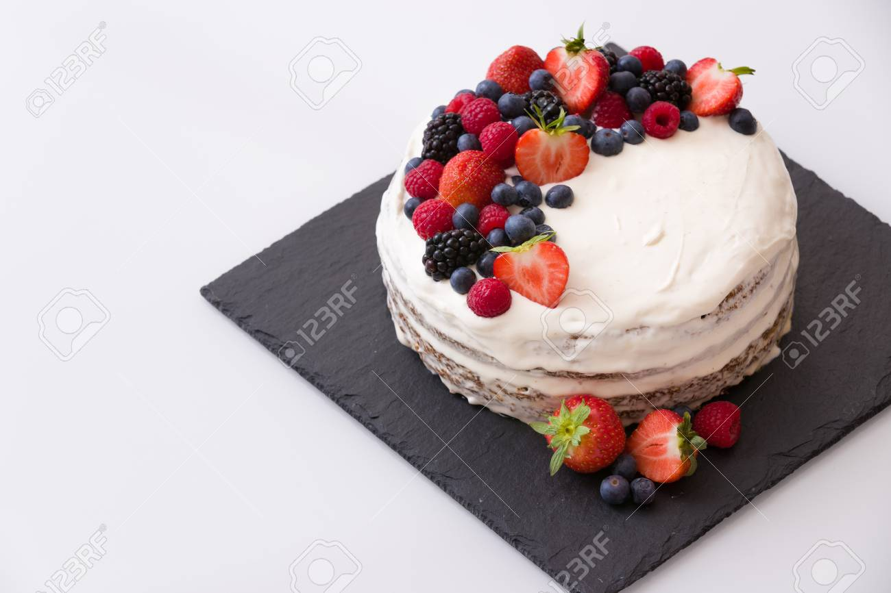 Delicious Homemade Nake Cake Decorated With Fresh Organic Berries