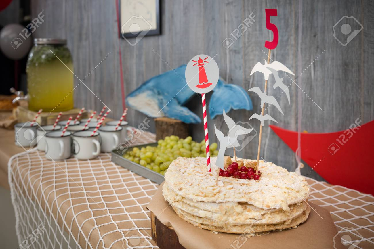 A Big White Birthday Cake With Fresh Organic Red Currants Number 5 And Nautical Theme