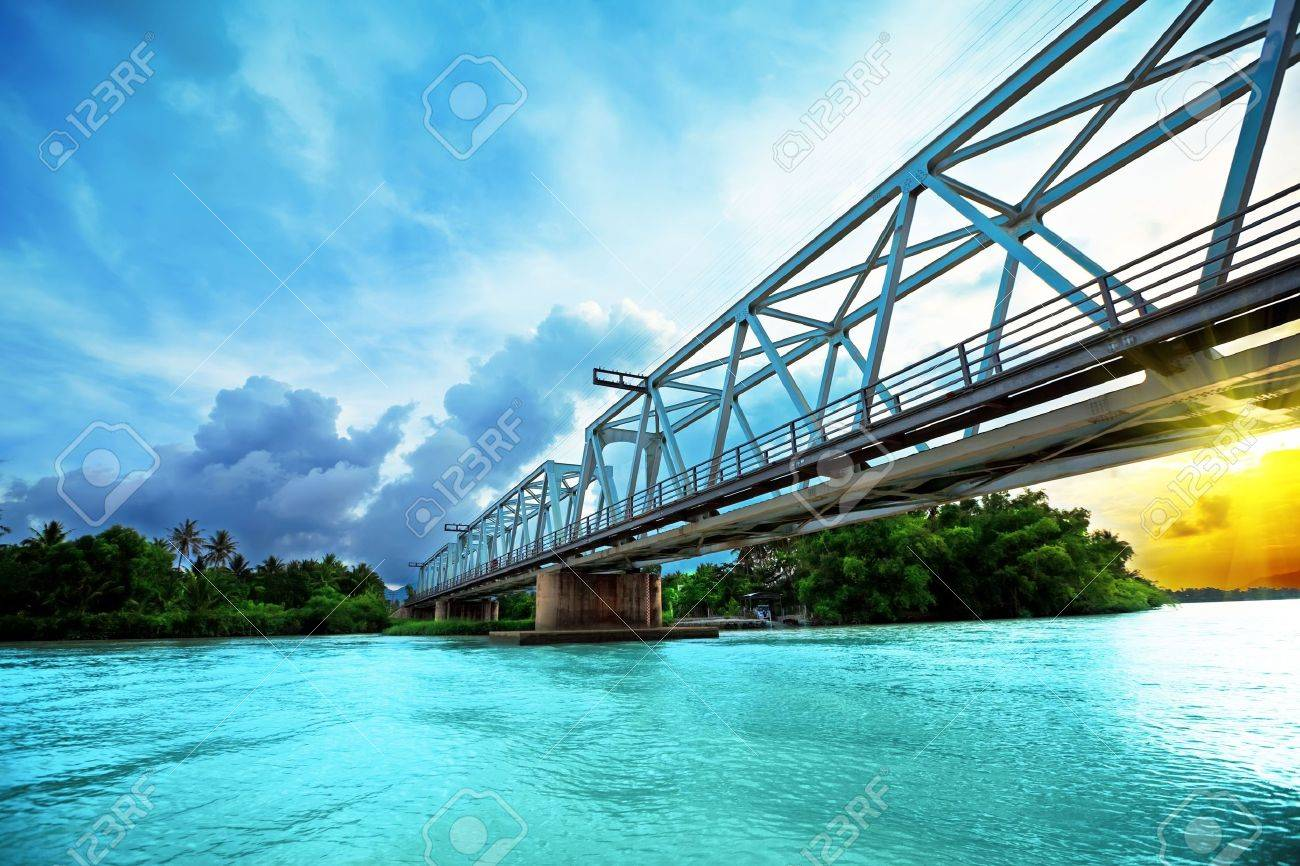 Railway bridge over the river at sunset time. Vietnam. Nha Trang Stock Photo - 4959709