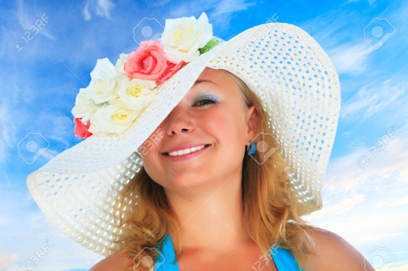 Young funny woman in hat with flowers Stock Photo - 6698728