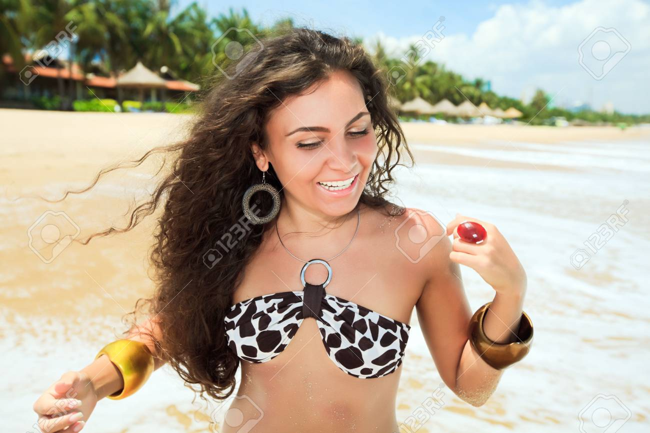 Young woman in bikini on the tropical beach Stock Photo - 6881866