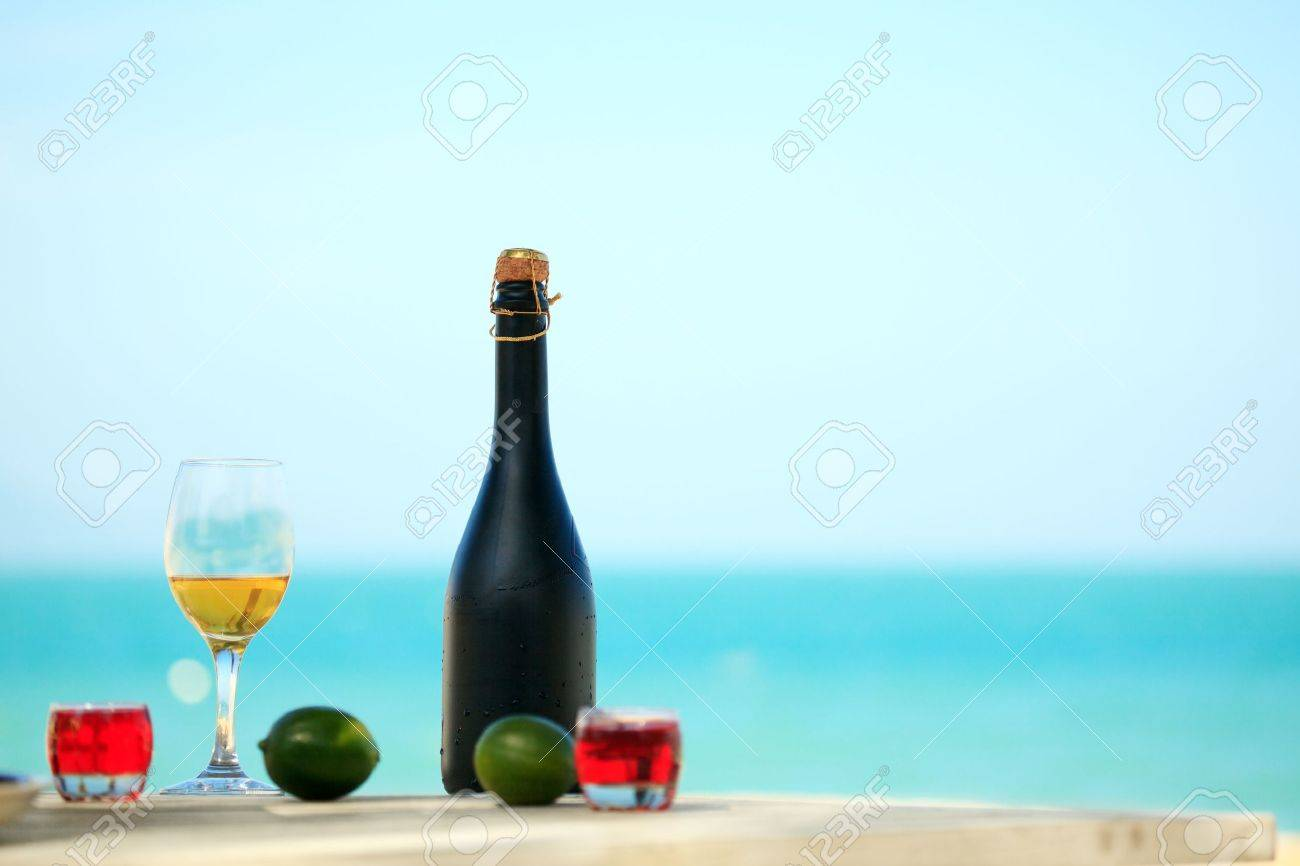 Bottle and glass of wine on the beach Stock Photo - 7165541