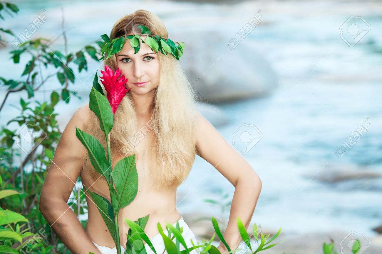 Beautiful woman as a forest nymph on the river Stock Photo - 7598251