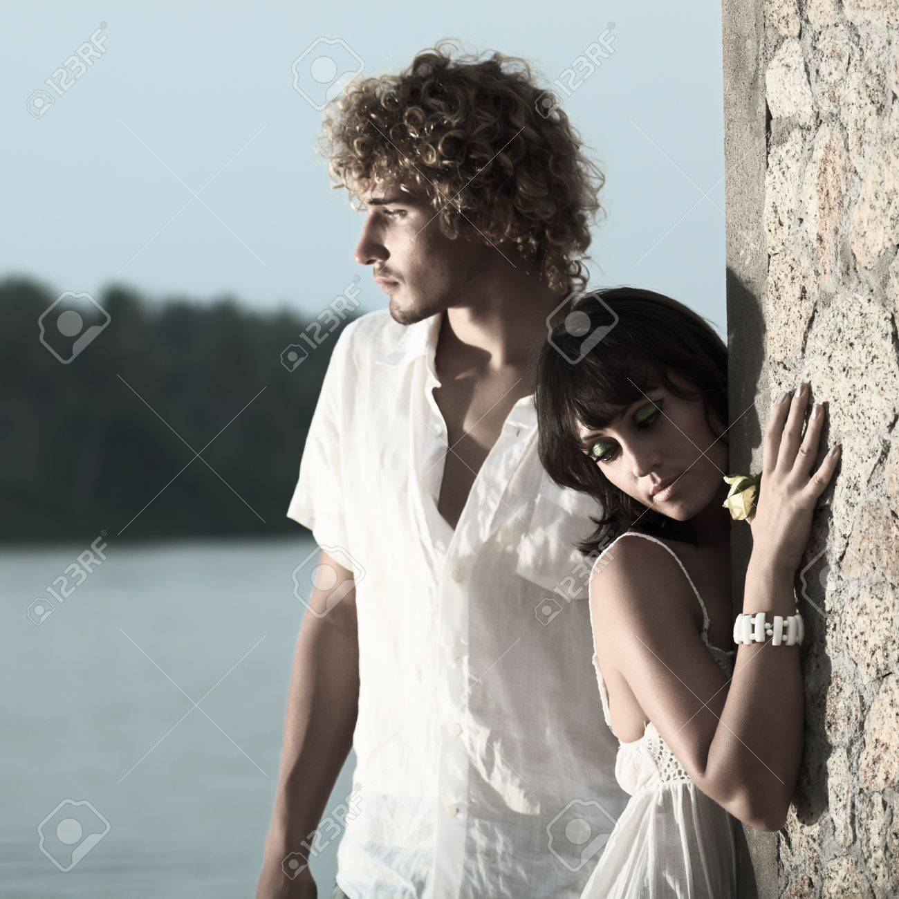 Young couple near the river at twilight time Stock Photo - 8144538
