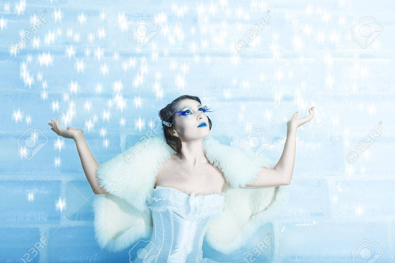 Christmas woman as a snow queen in ice room Stock Photo - 8356133