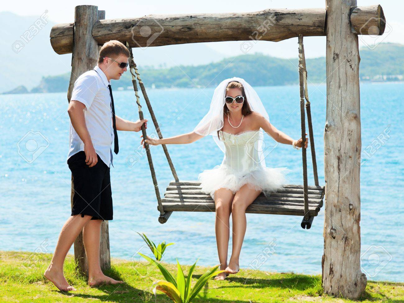 Bride and groom on the tropical beach Stock Photo - 10452160