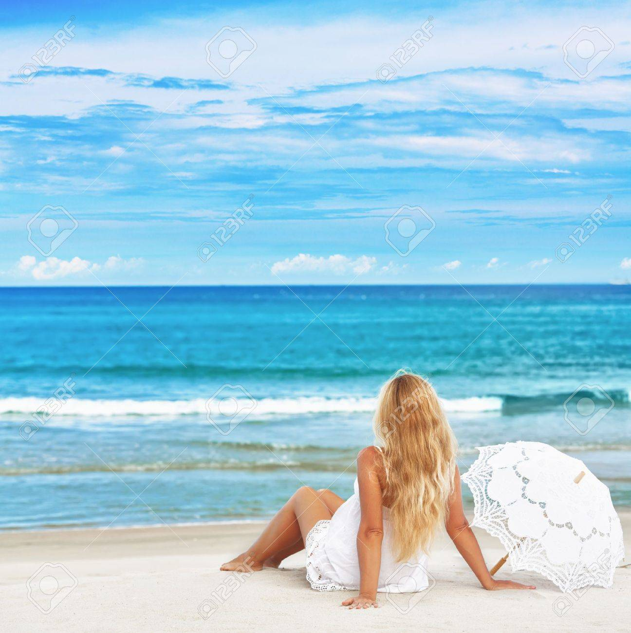 Woman with umbrella on the tropical beach Stock Photo - 10947185