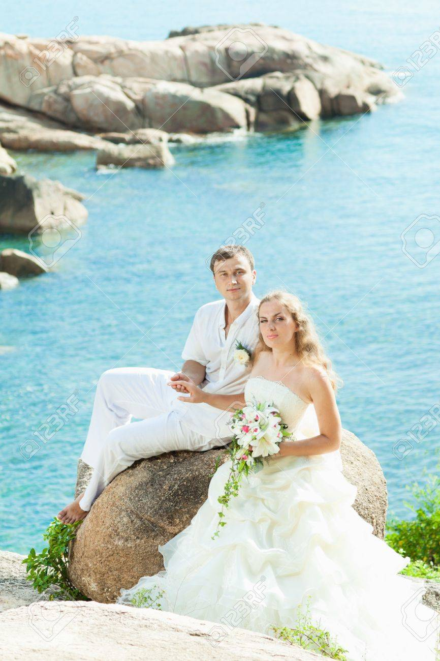 Bride And Groom On The Beach. Tropical Wedding Stock Photo, Picture ...