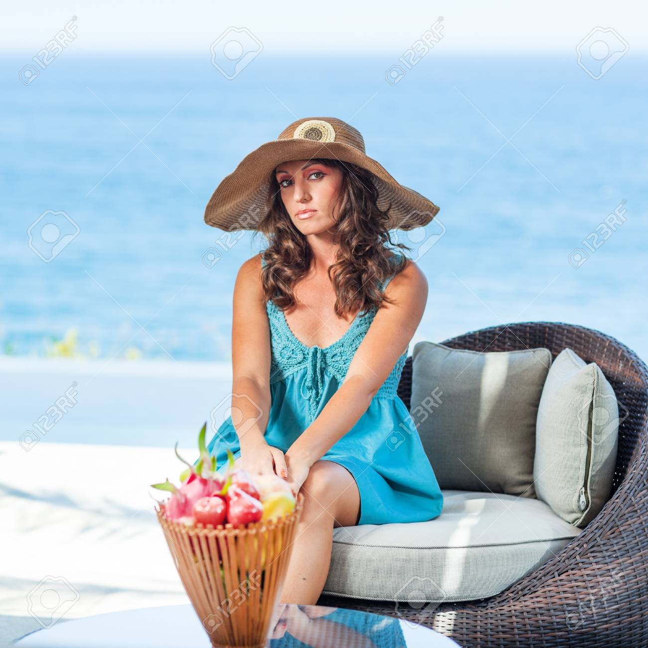 Woman in hat near the pool Stock Photo - 13545675