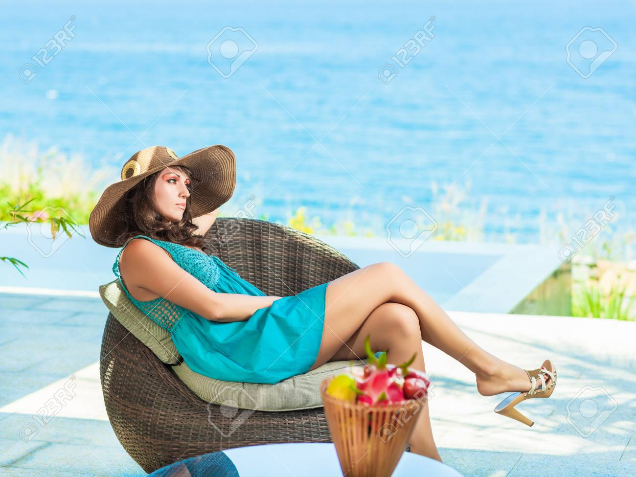 Woman in hat near the pool Stock Photo - 13545720