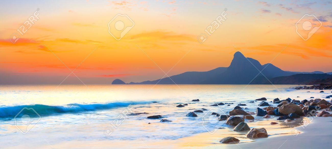Sunset over the sea  Stone on the foreground  Panorama Stock Photo - 14476024