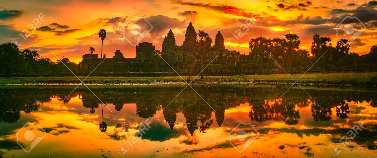 Angkor Wat temple reflecting in water of Lotus pond at sunrise. Siem Reap. Cambodia. Panorama - 115869220
