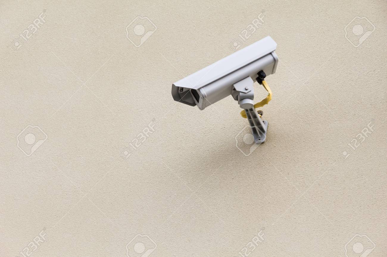 white security camera mounter on wall Stock Photo - 16022143