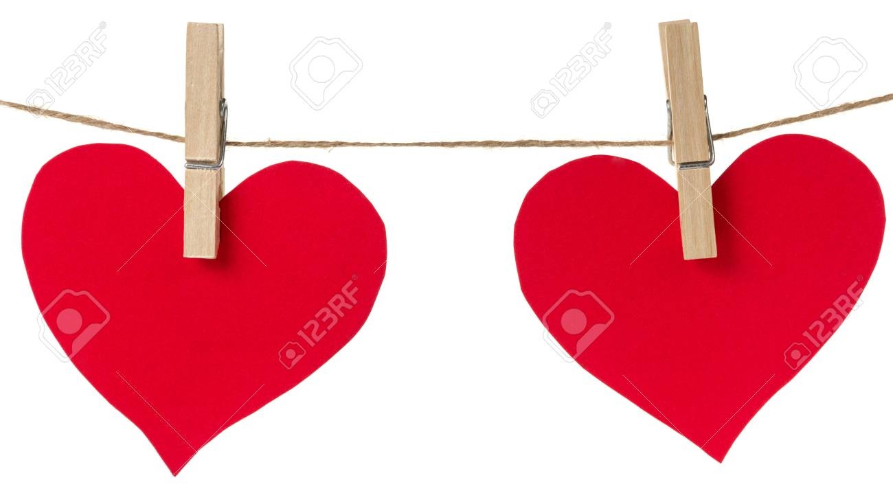two red paper hearts hanging, isolated on white Stock Photo - 17030364