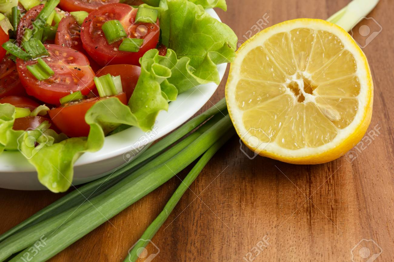 fresh light salad with cherry tomatoes and chives, on table Stock Photo - 18023740