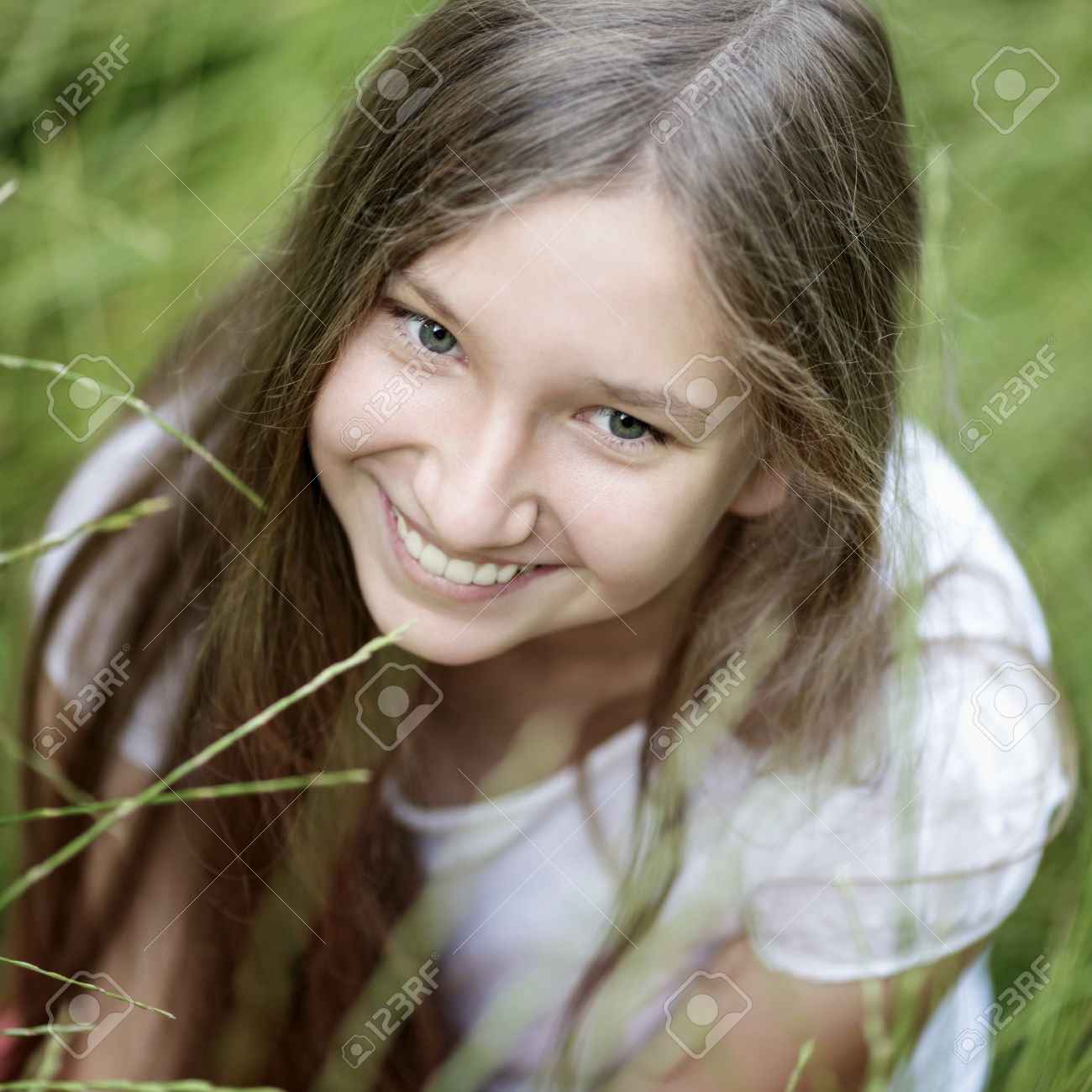 portrait of beautiful teen girl on the grass, upper point Stock Photo - 21228790