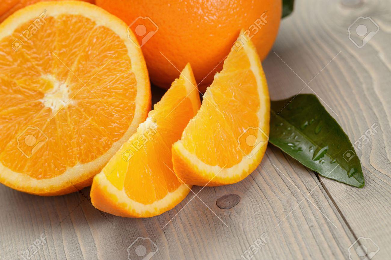 ripe spanish oranges on wood table, rustic photo - 35243489