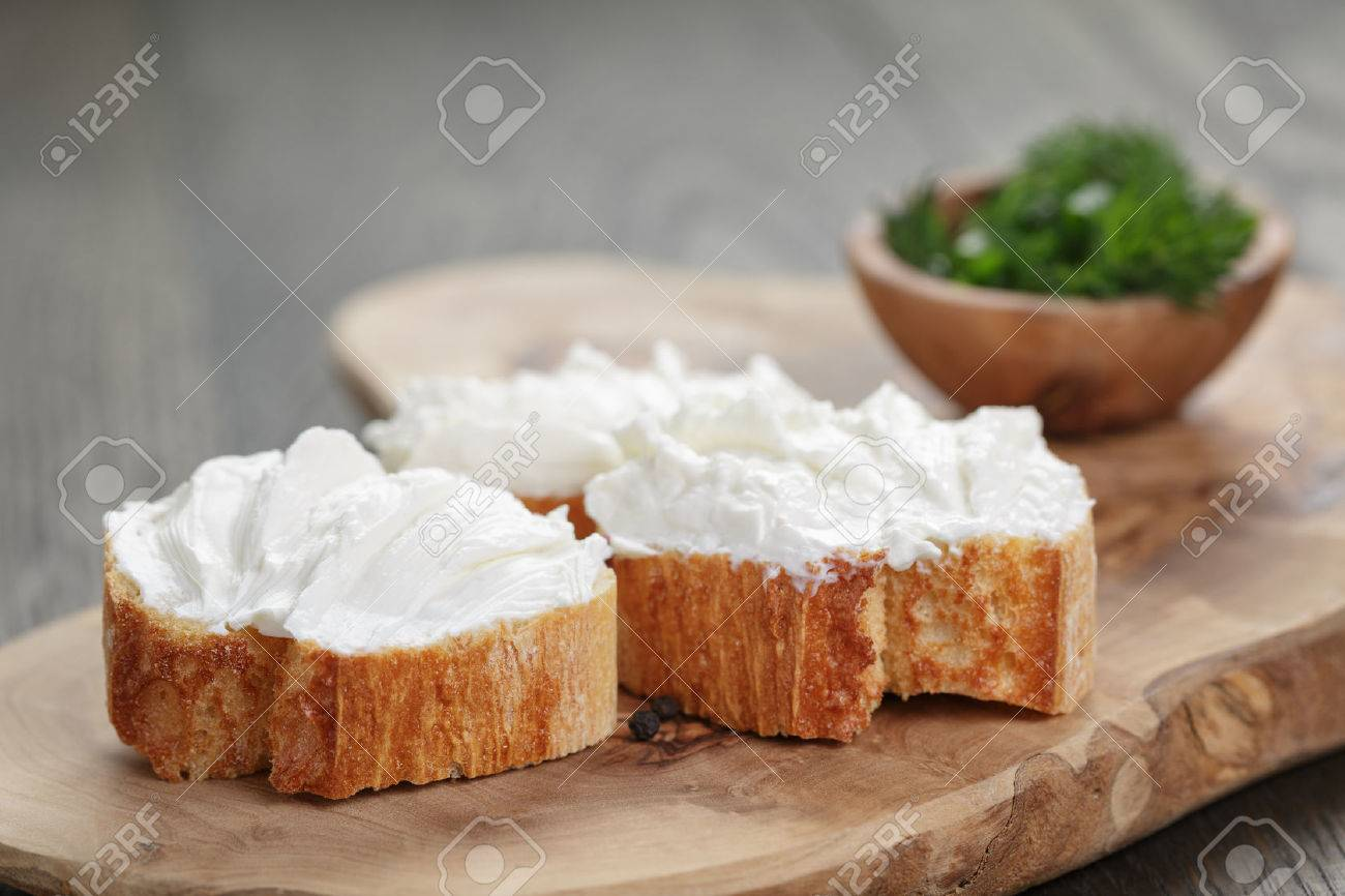 homemade appetizing crostini with soft cheese cream herbs - 38676155