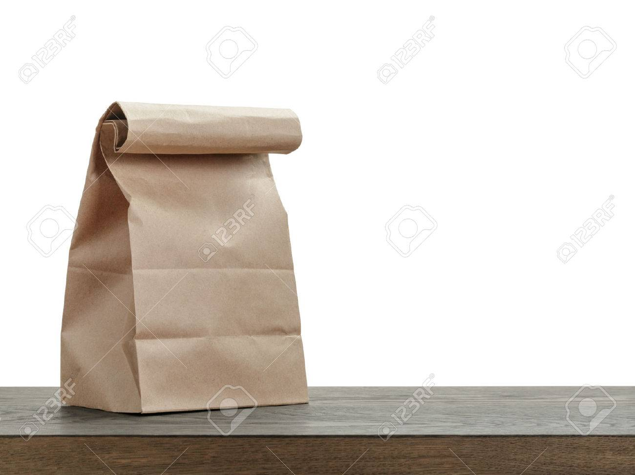simple brown paper bag for lunch or food on wooden table - 39104958