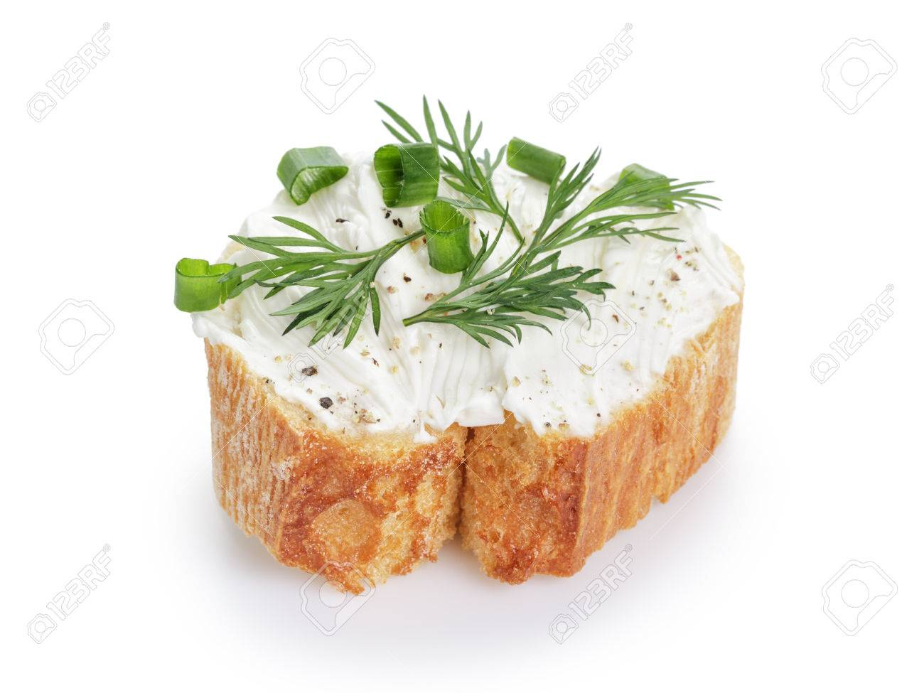 crunchy baguette slice with cream cheese and herbs isolated - 39104994