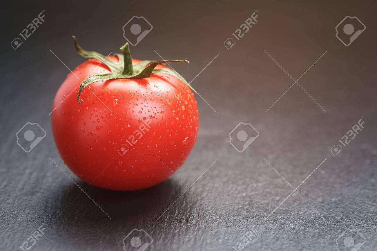 ripe tomato on slate board, vintage toned - 44909634