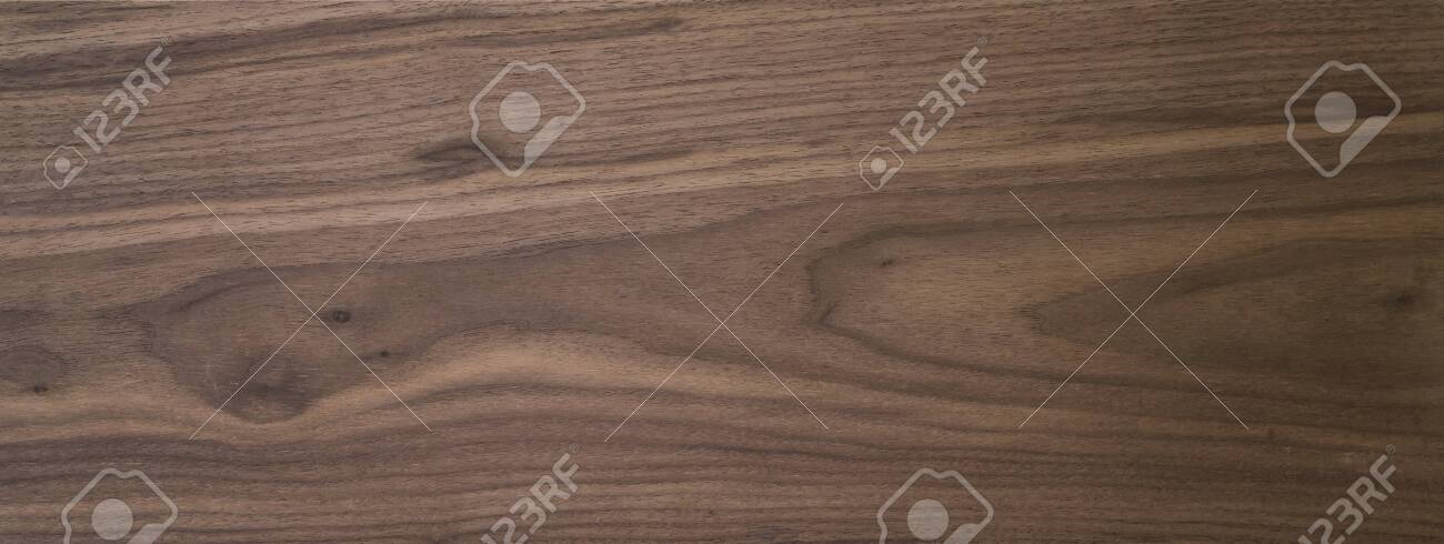 Black walnut wood texture of solid board untreated