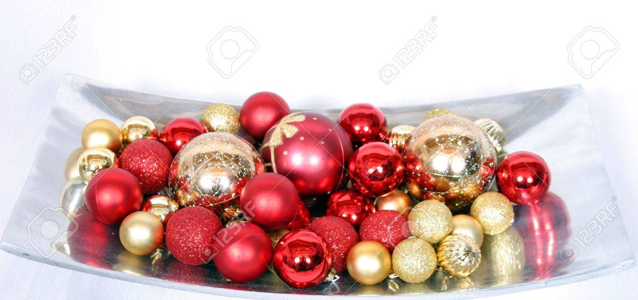 Red And Gold Christmas Tree Ornaments In Silver Tray On White Stock Photo Picture And Royalty Free Image Image 659652
