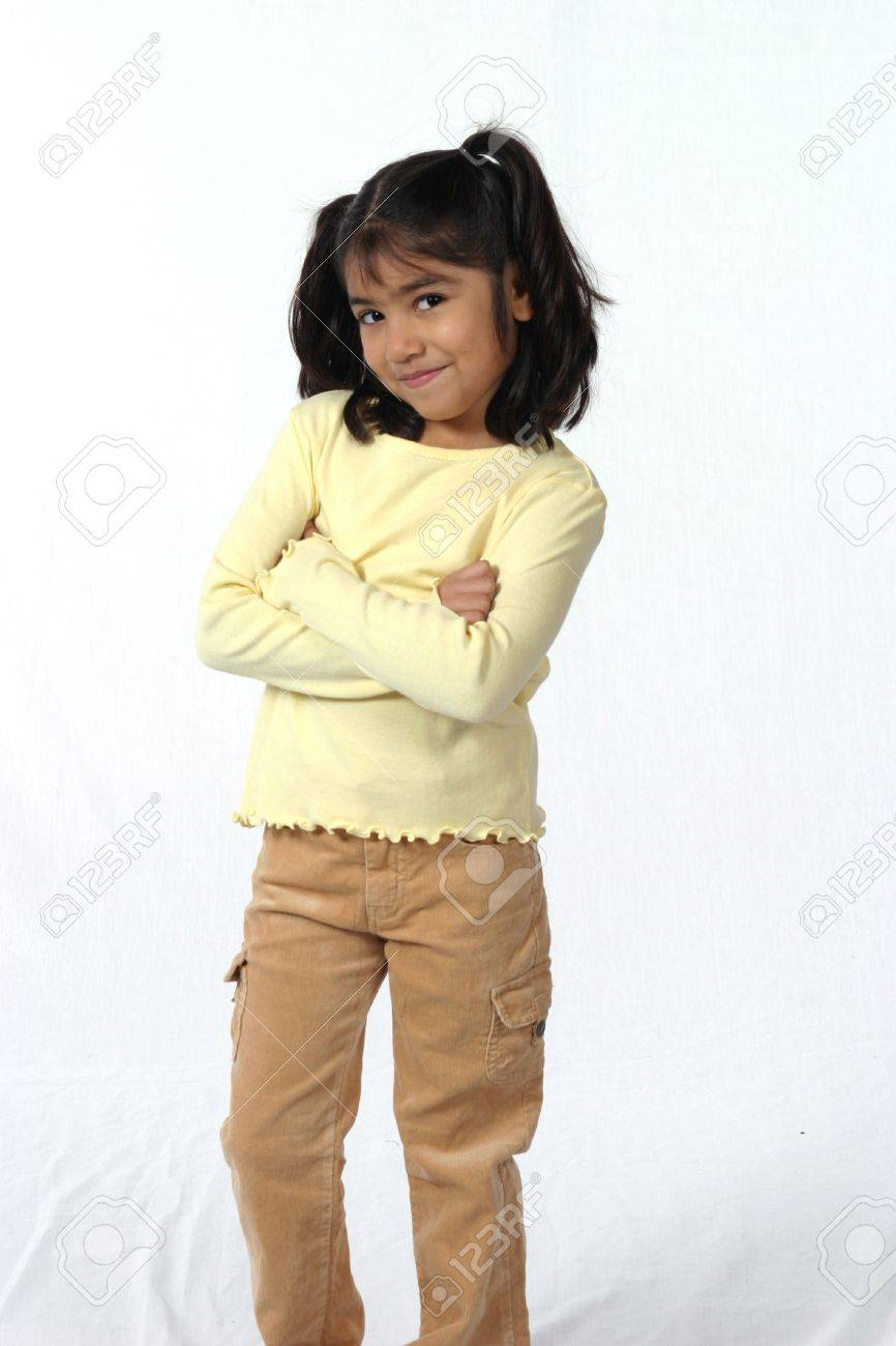 little naked girl cute little girl with dark hair and eyes with crossed arms Stock Photo -  662383