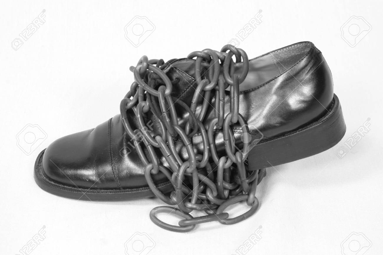 black oxford dress shoe wrapped in bronze chain Stock Photo - 3054906
