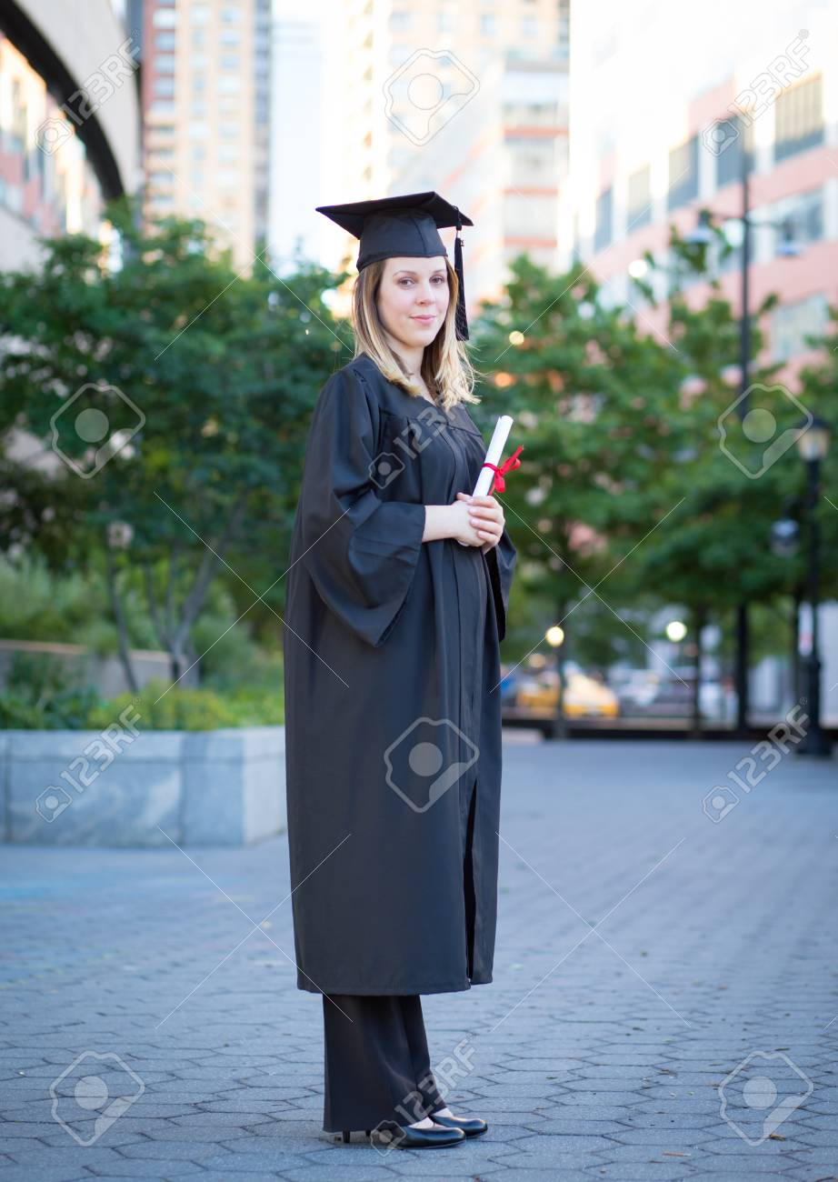 Portrait Of Female College Student In Graduation Cap And Gown ...
