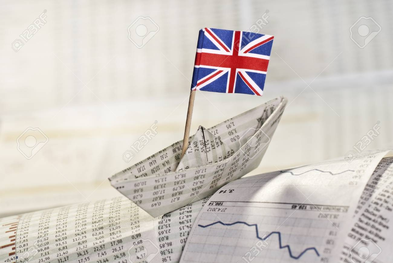 Paper ship with British flag on stock market news. Stock Photo - 28045066