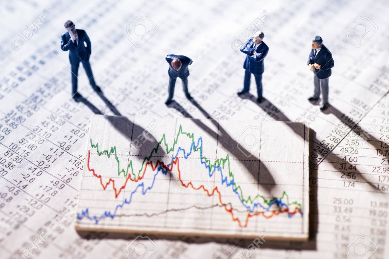 Businessmen are skeptical looking at stock market charts. - 94388214