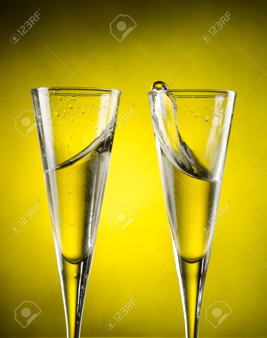 Celebration toast with champagne on yellow background Stock Photo - 13599594