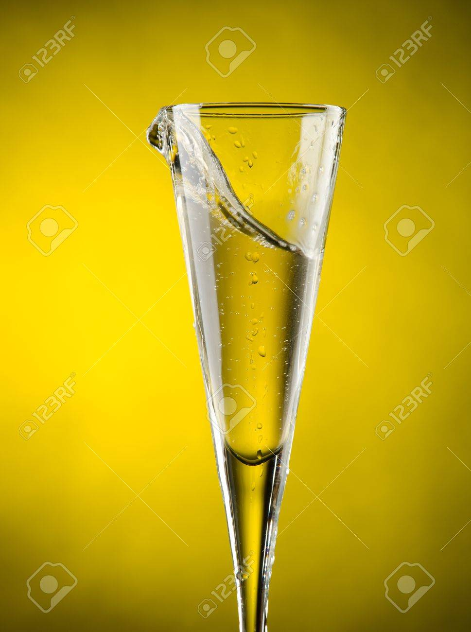 Glass of Champagne with yellow background Stock Photo - 13599734