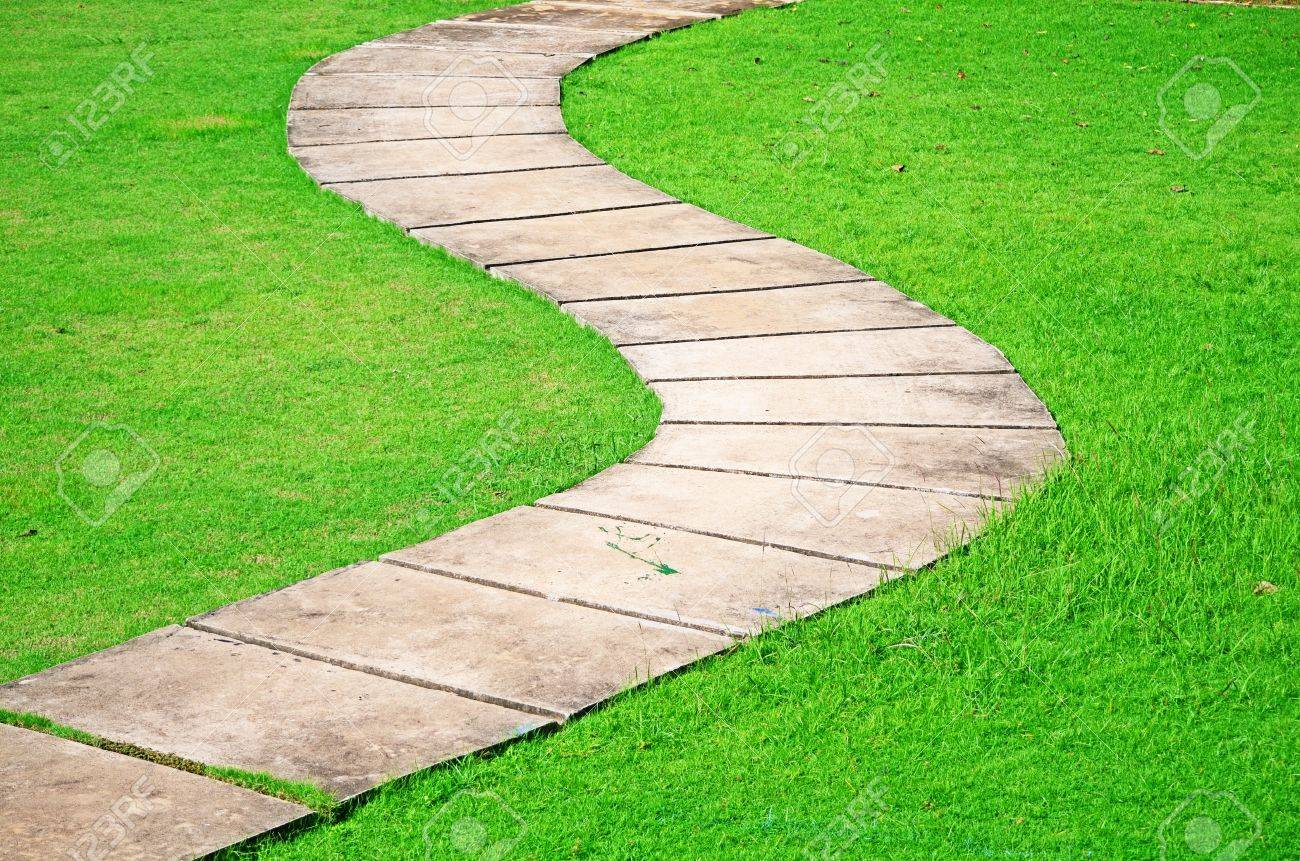 S-Curve Pathway Passed Green Grasses Field Stock Photo, Picture ...