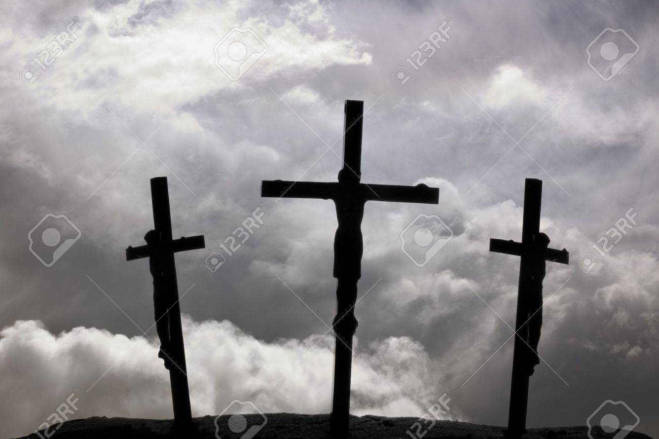crucifixion of jesus on the cross with two crosses beside him