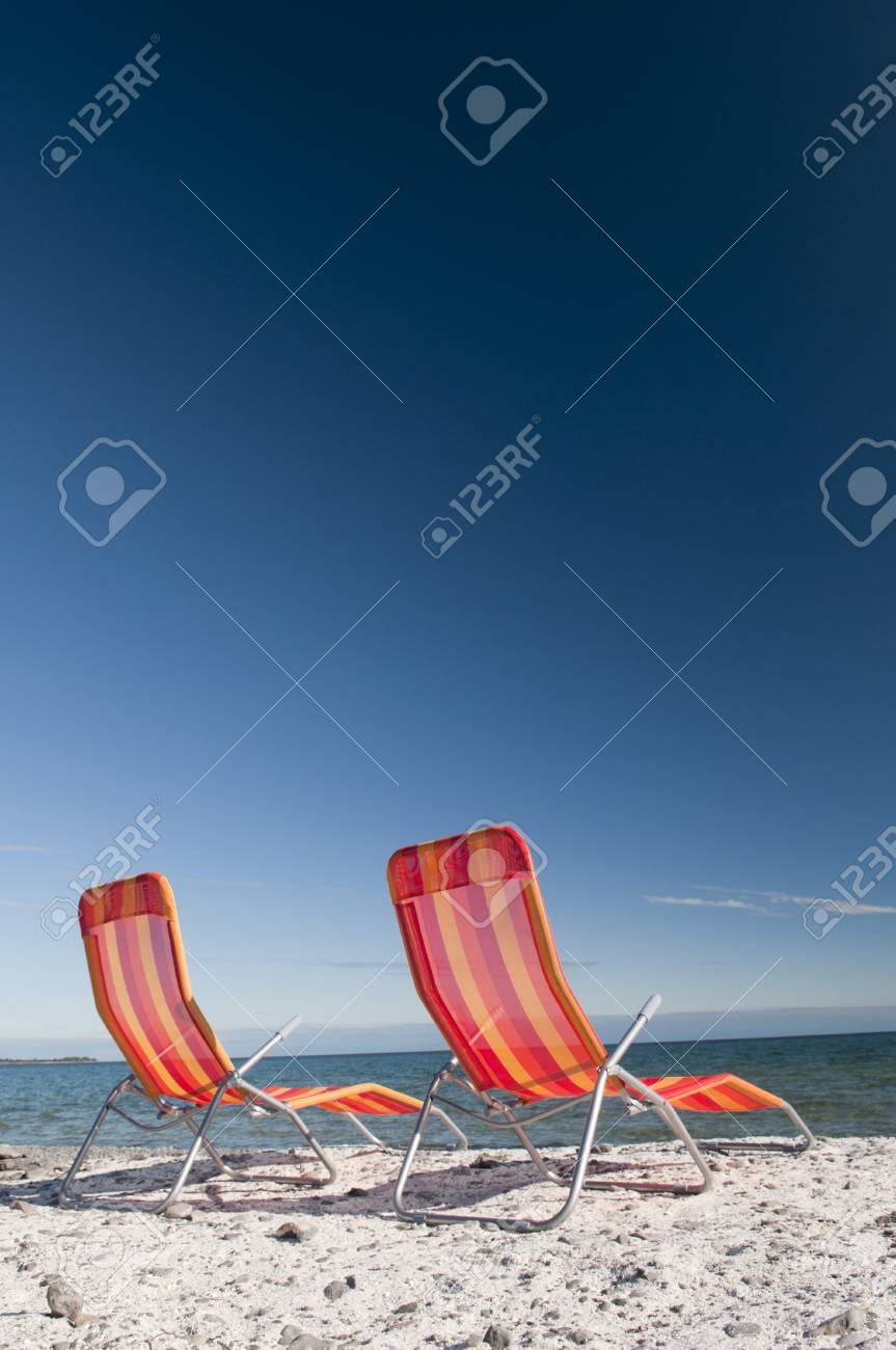 Terrific Lounging Beach Chairs On The Lake Ontario Shoreline With Large Ocoug Best Dining Table And Chair Ideas Images Ocougorg