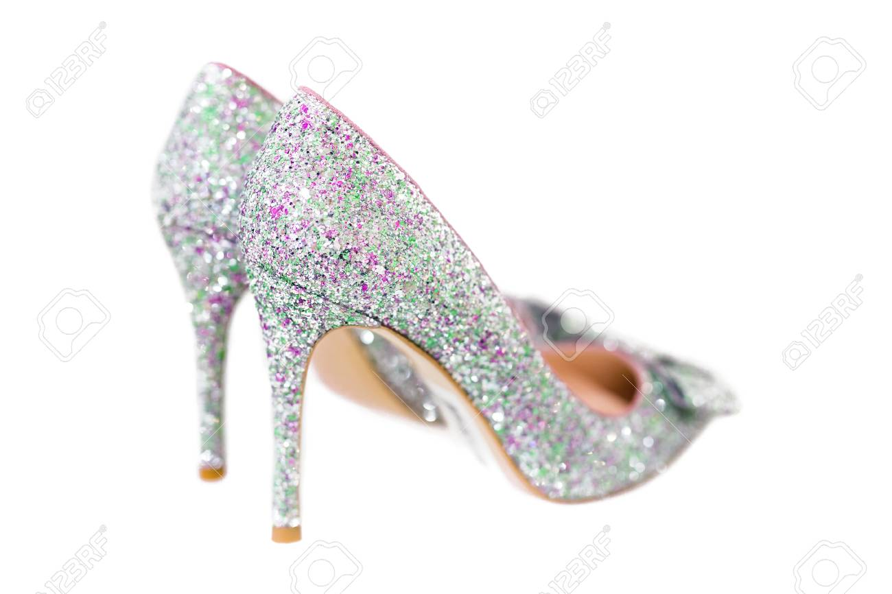 fd4b35e5ad7 Beautiful silver glitter high heel female shoes isolated on white. Wedding  accessories . Cinderella shoes