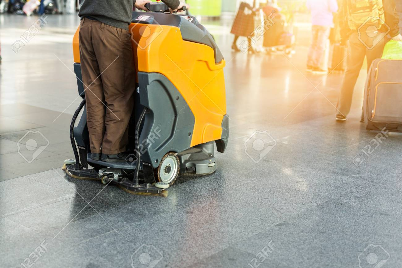 Man Driving Professional Floor Cleaning Machine At Airport Or